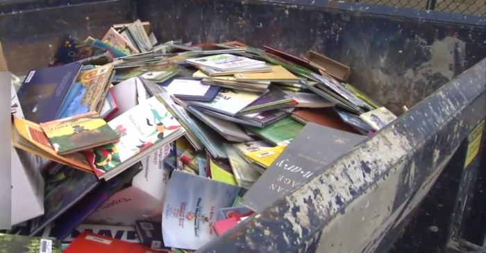 Dumpster filled with books discovered behind elementary school, and it's not the first time