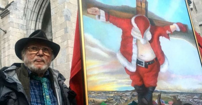 A painting portraying Santa Claus on the cross outrages churchgoers outside a historic cathedral
