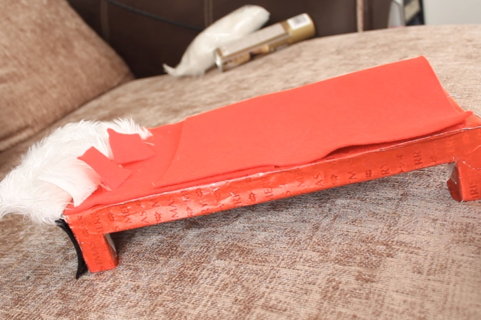 She transforms a cereal box into an adorable bed for her Elf on the Shelf