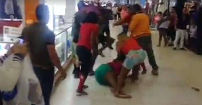 Deck the halls with bouts of folly! Christmas shopping exploded into a mall brawl in Florida