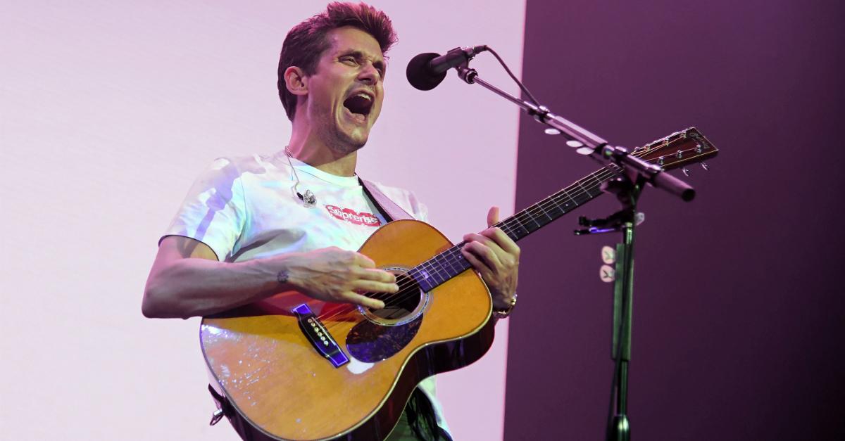 "John Mayer is ""in good spirits"" following the emergency surgery that left him bed ridden"