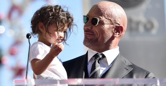On Christmas morning, The Rock shared a video featuring a feisty family member that will melt your heart