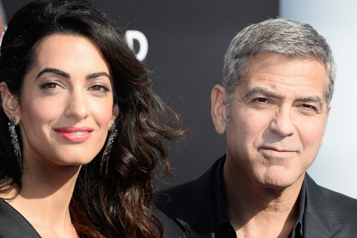 George and Amal Clooney came bearing gifts for fellow passengers on a commercial flight with the twins