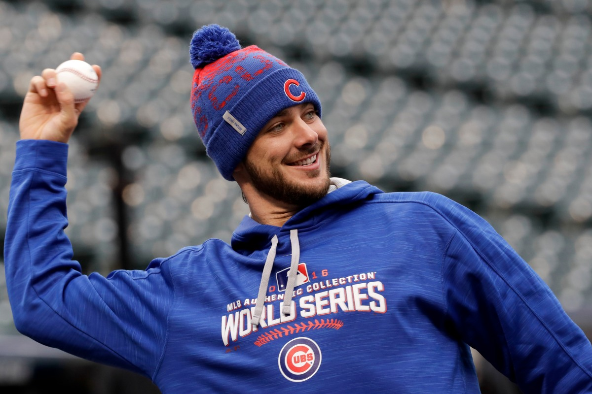 Kris Bryant tests his skills on a race track while on his honeymoon