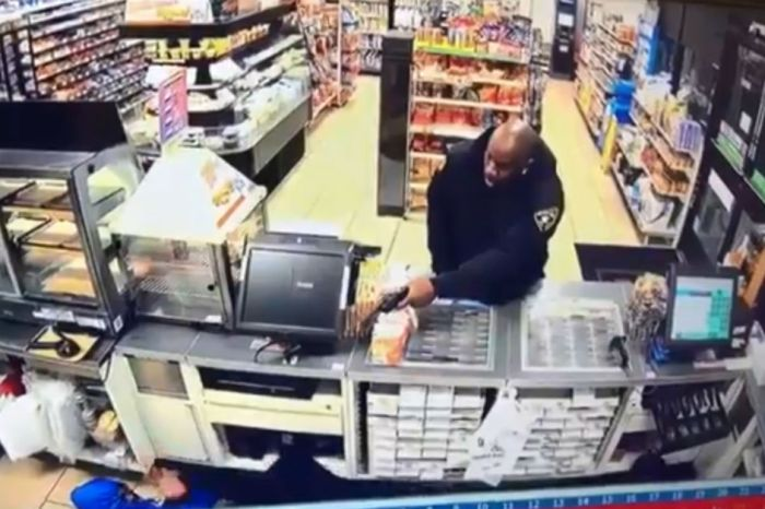 Badass security guard teaches idiot robbers not to bring a fake gun to a gun fight