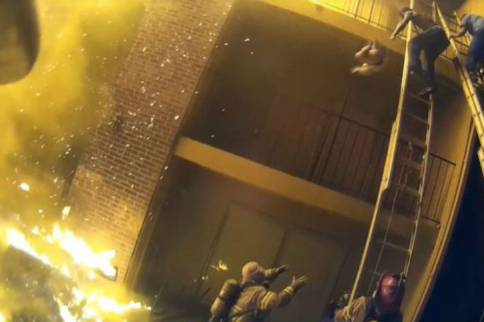 Video of firefighter catching child thrown from flaming balcony emerges online
