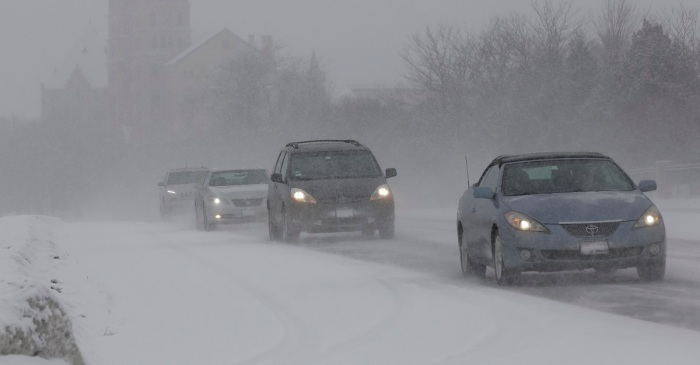 Slick road conditions led to over 100 car crashes across the Chicagoland area late Tuesday and early Wednesday