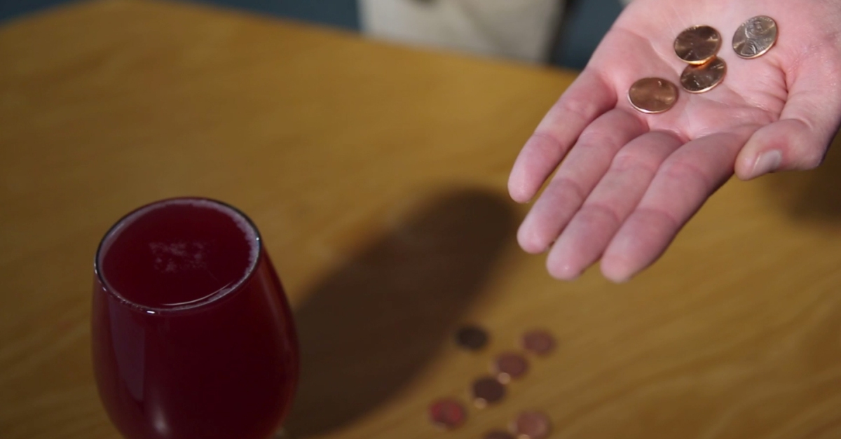 How many pennies can you add to a full wine glass before it overflows?