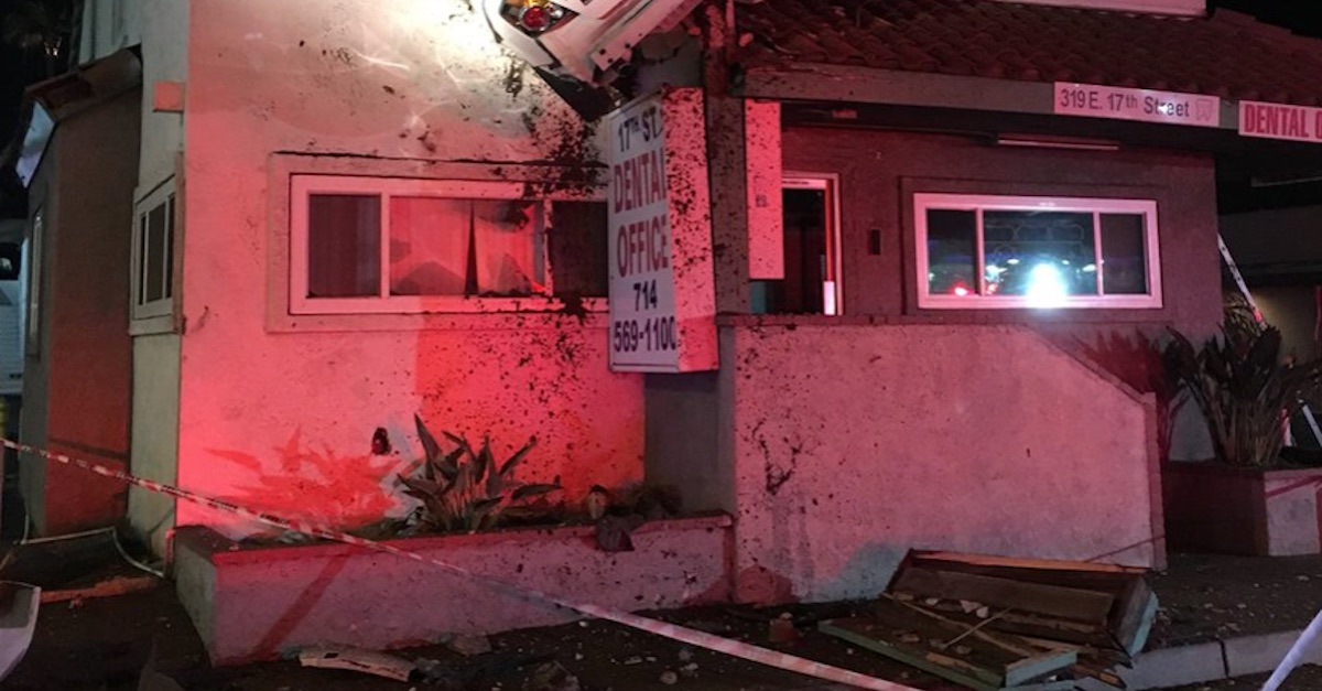 A car somehow ended up on the second floor of a dental office, and the driver was allegedly sky-high