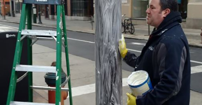 """The """"Crisco Cops"""" attempted to thwart Eagles fans from climbing lightpoles — and they failed"""