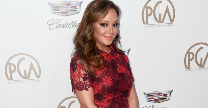 Leah Remini walked the red carpet in a floral print red gown and looked absolutely stunning