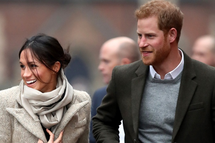 Prince Harry and Meghan Markle looked cozy in their first public engagement before the royal wedding