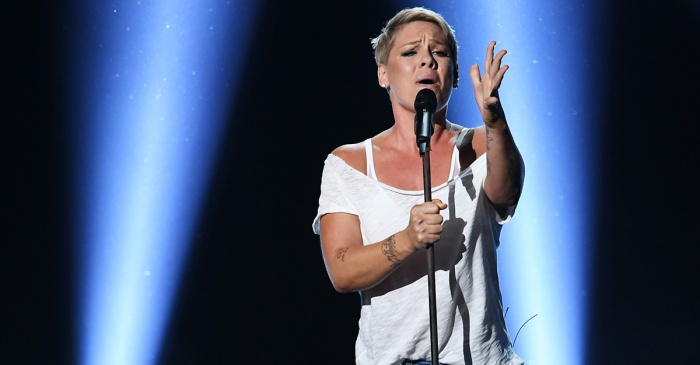 Pink traded in a death-defying performance for a tearjerking ballad at this year's Grammys