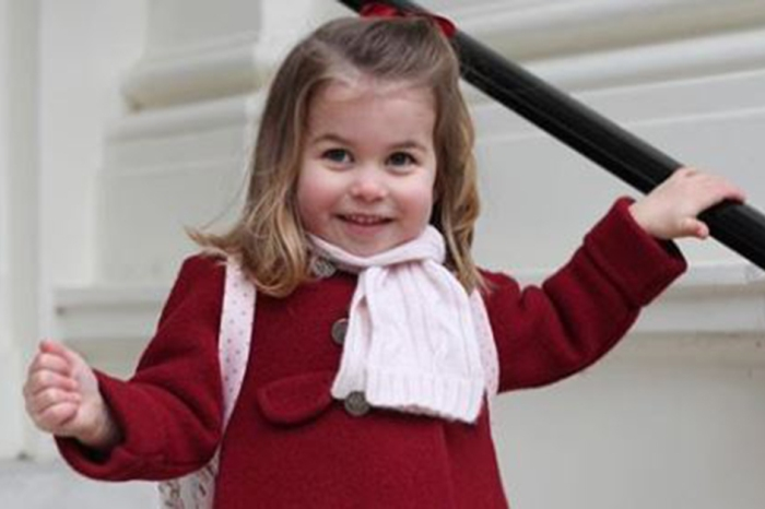 The queen says Princess Charlotte bosses her older brother Prince George around