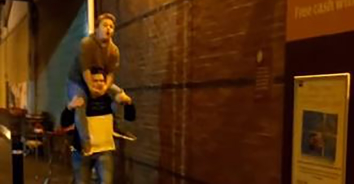 Man climbs up onto friend's shoulders — and then things take a regrettable turn