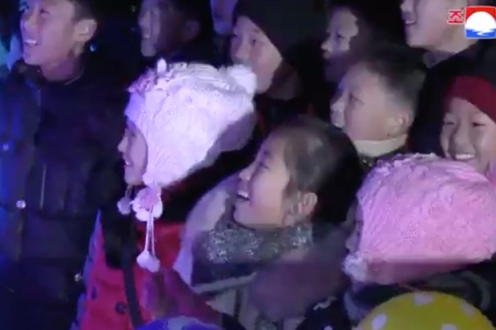 Look at all of these North Koreans supposedly enjoying ice sculptures of nuclear missiles and dolphins