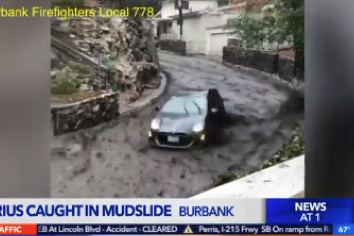 Prius owner instantly regrets driving through the California mudslides when a wave sweeps him away