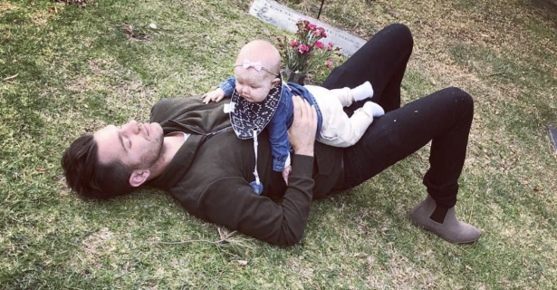 Singer Andy Grammer takes his daughter to visit the grave of someone special in her life