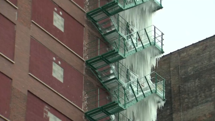 Check out these amazing photos from a burst pipe that created a 21-story ice sculpture