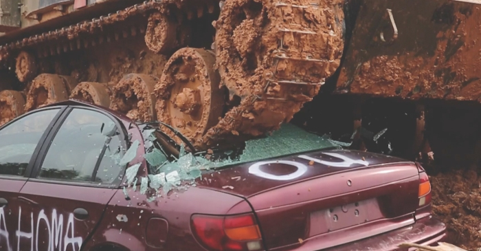 A smashing idea: In this Georgia town, you can pay to drive around and crush cars in a tank