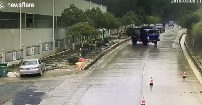 Watch the moment 3 identical trucks slip and slide down a slick road in China