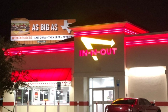 Whataburger is still trolling In-N-Out in this city because that's how it's done in Texas