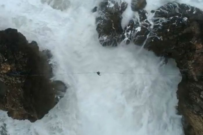 A drone filmed daredevils on a tightrope between two cliffs, and it's giving us anxiety