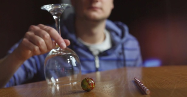 This bouncy ball bar trick seems to defy the laws of gravity