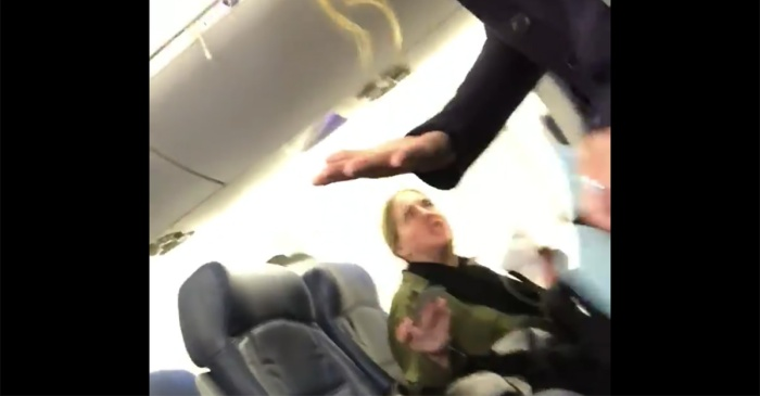Watch a foul-mouthed woman get booted off her flight for being mean to a mom and her baby