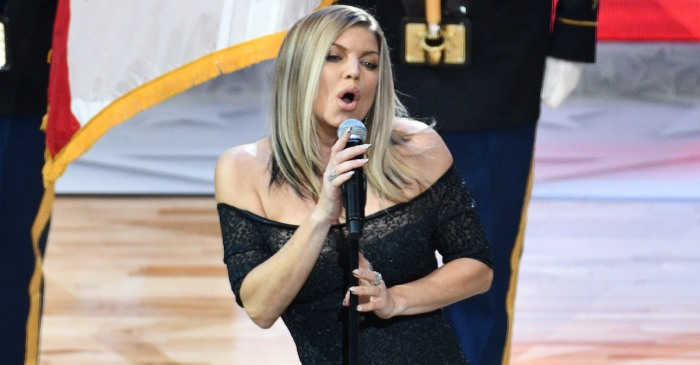Mariah Carey is defending Fergie after a weird national anthem, and we know just why