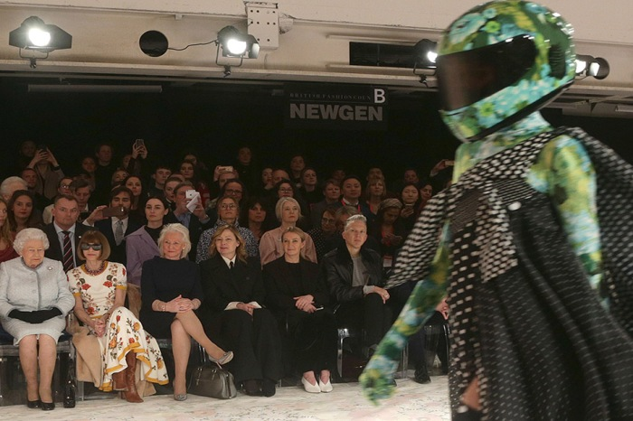 Queen Elizabeth II has the world in a tizzy after showing off her fashion chops at London Fashion Week