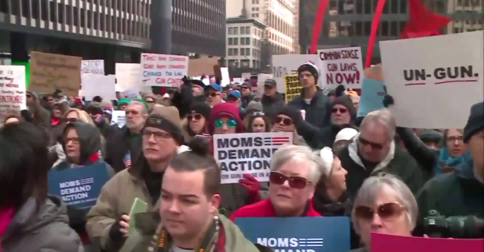 Thousands gathered in downtown Chicago on Sunday to call for gun legislation in wake of recent mass shooting