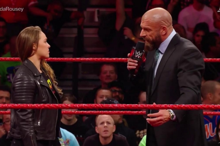 UFC's Ronda Rousey attacked WWE superstar Triple H last night on live TV