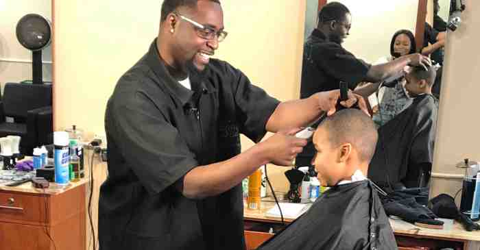 Local barber creates change with charity program