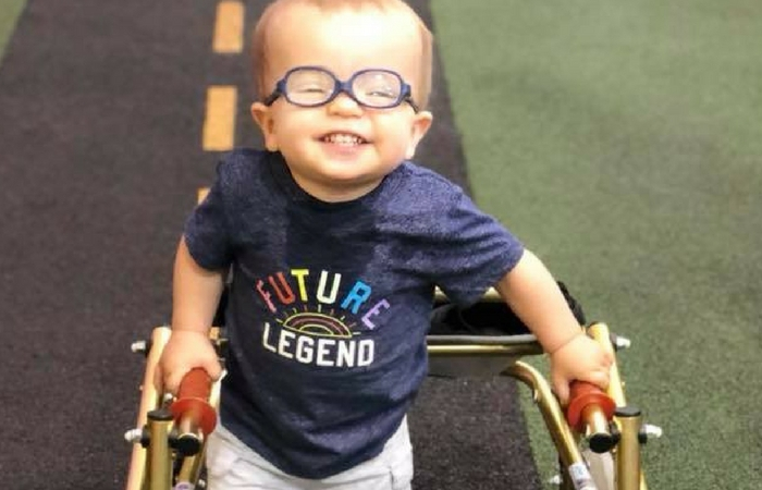 Toddler with Spina Bifida Takes First Steps Alongside His Furry Friend
