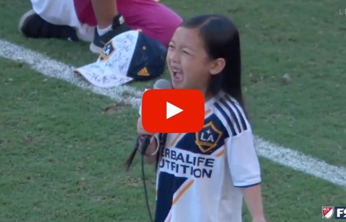 7-Year-Old Stuns Crowd With Epic Rendition of the National Anthem