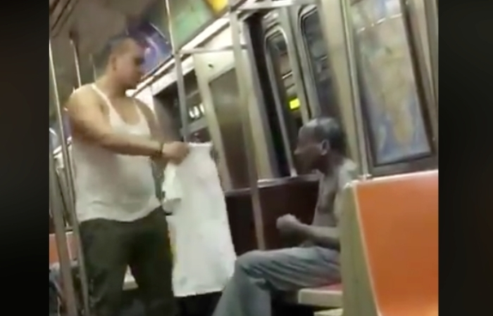 Subway Passenger Gives Shirt Off His Back to Freezing Homeless Man