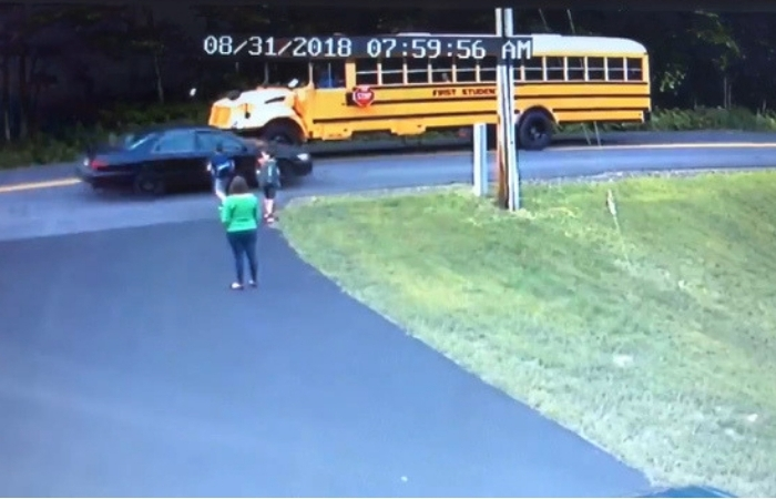 Shocking Video Shows Boy Nearly Hit By Speeding Car At School Bus Stop