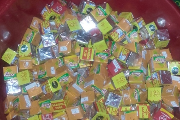 Woman Handing Out Chicken Bouillon Cubes on Halloween to Trick Trick-or-Treaters