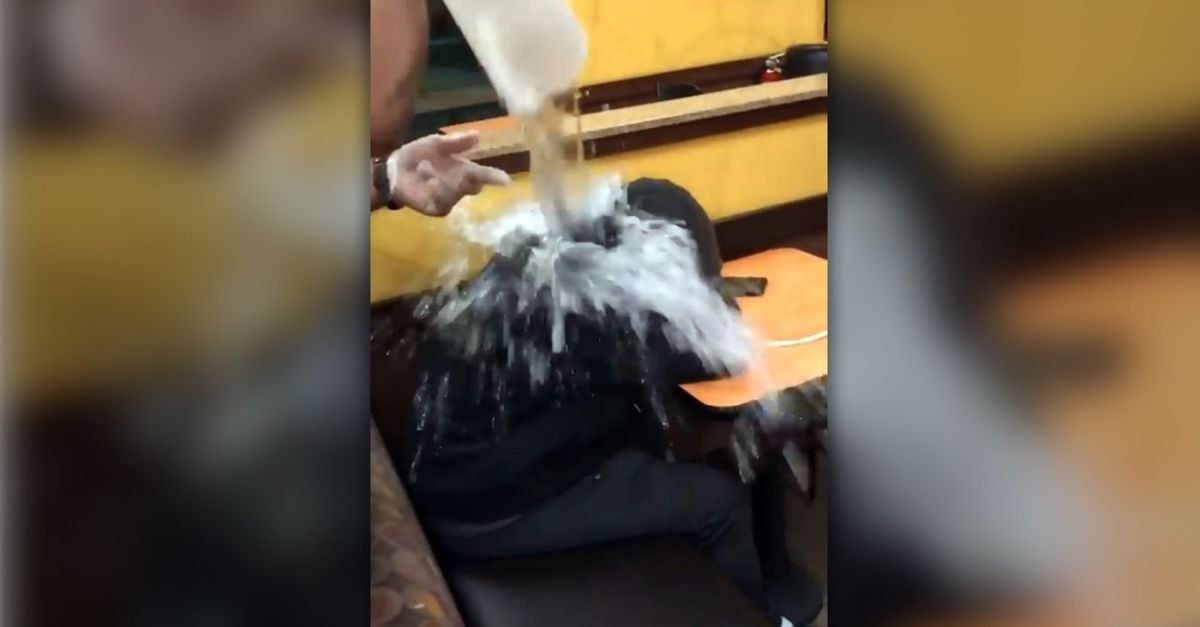 Video Shows Dunkin' Donuts Employee Throwing Water on Homeless Man