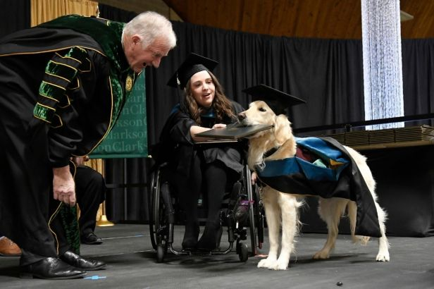 Service Dog Graduates With Master's Degree Alongside Owner