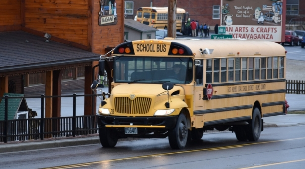 Dad Storms Onto School Bus with Gun to Confront Son's Bully