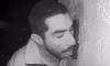 man licking doorbell