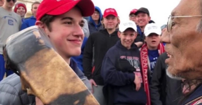 Students in 'MAGA' Hats Mock Native American After Rally