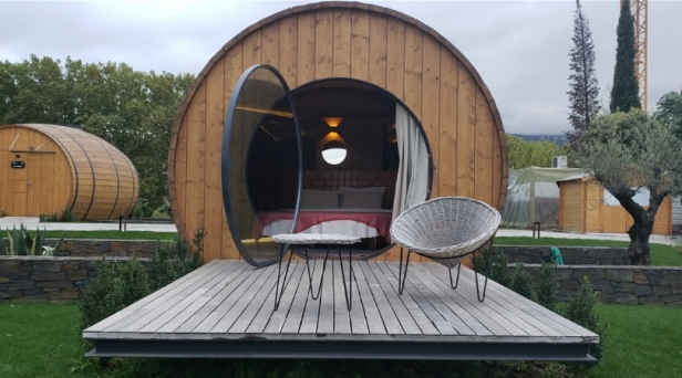 Do You Love Wine? This Vineyard Lets You Sleep Inside a Giant Wine Barrel!