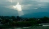 Woman Captures Image of Jesus Shining Through the Clouds