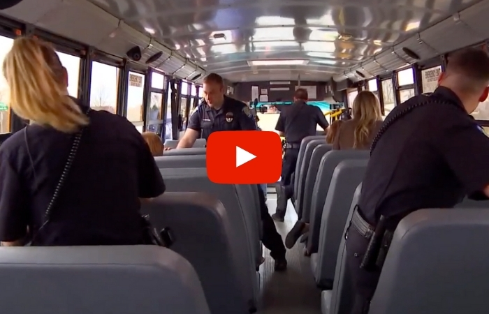 Police Officers Aim to Stop Distracted Drivers By Riding School Buses Around Town