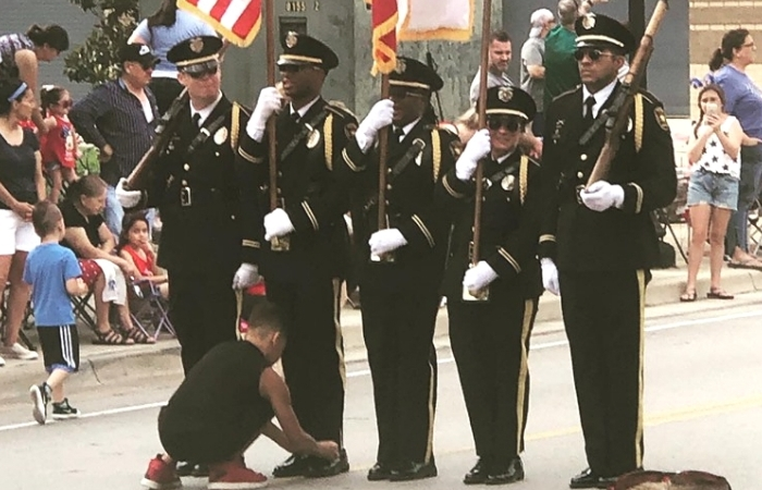 Texas Boy Praised for Tying Honor Guard Member's Shoe During 4th of July Parade