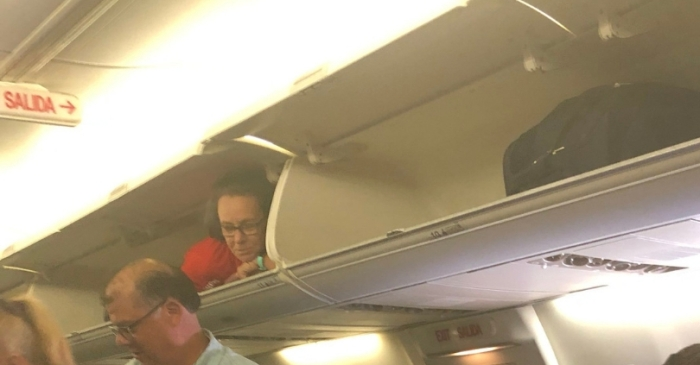Southwest Airlines Flight Attendant Crawls Into Overhead Compartment To Greet Passengers