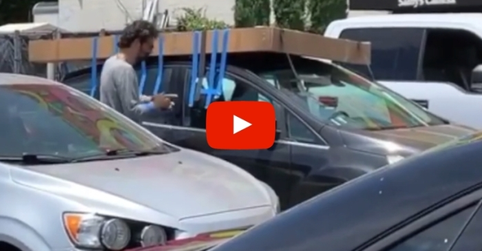 Dumb Driver Tapes Large Cardboard Box To Roof of Car, Because That Will TOTALLY Work